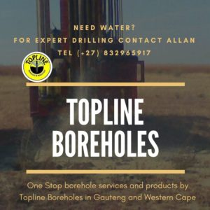 An industrial machine drilling for water in open land area by Topline boreholes in gauteng
